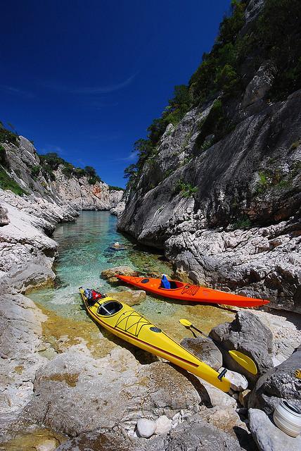 Two canoes at the end of Porto Pedrosu, Sardinia, Italy