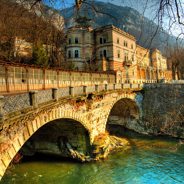 by cotropitor on Flickr.Bridge crossing Cerna river in Baile Herculane thermal spa resort, Romania.