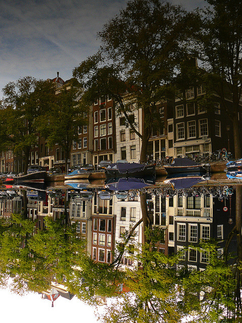 Buildings reflected in the Singel canal, Amsterdam, Netherlands