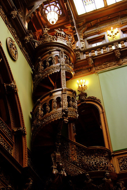 Wooden spiral staircase inside the Peles Castle, Romania